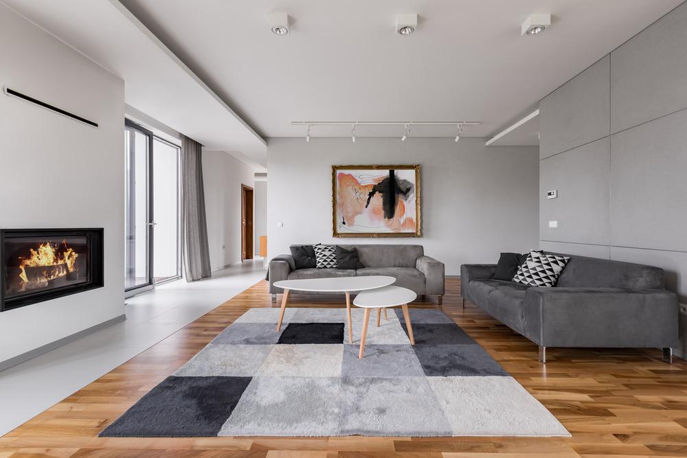 make laminate floor less slippery using area rugs